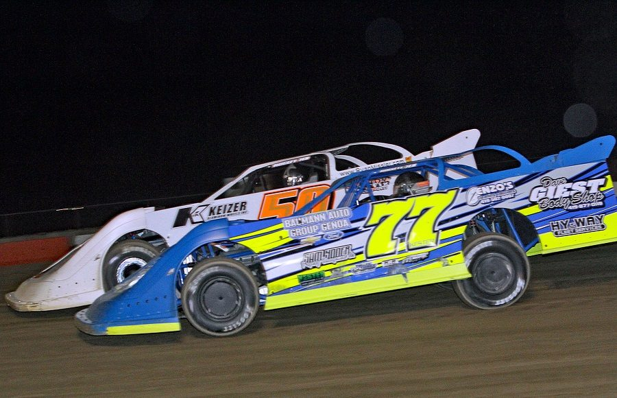 Steve Kerster (77) battles Ryan Missler during Friday's American Ethanol Late Model Tour event at Attica Raceway Park. (Jim Denhamer Photo)