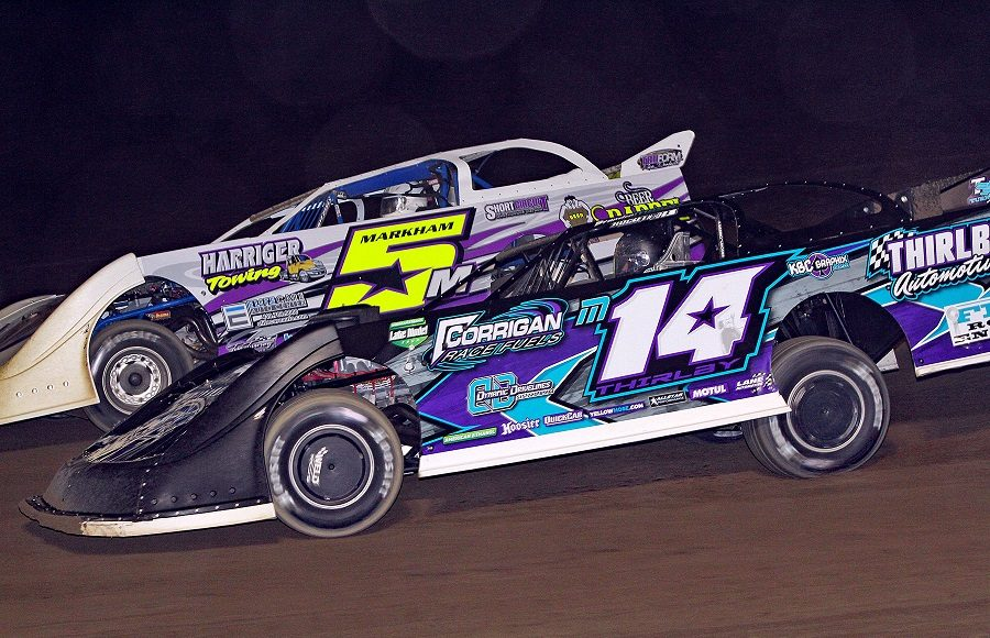Brandon Thirlby (14) races under Ryan Markham during Friday's American Ethanol Late Model Tour event at Attica Raceway Park. (Jim Denhamer Photo)