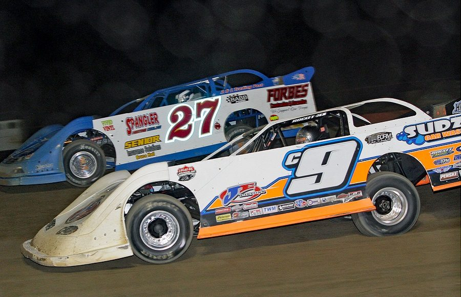 Steve Casebolt (C9) races alongside Eric Spangler during Friday's American Ethanol Late Model Tour event at Attica Raceway Park. (Jim Denhamer Photo)
