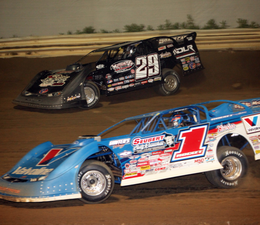 Brandon Sheppard (1) and Darrell Lanigan battle for the lead at Ohio's Wayne County Speedway. (Rick Neff photo)