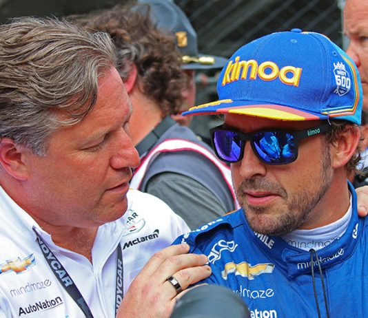 Fernando Alonso (right) talks with McLaren boss Zak Brown Sunday at Indianapolis Motor Speedway. (IndyCar Photo)