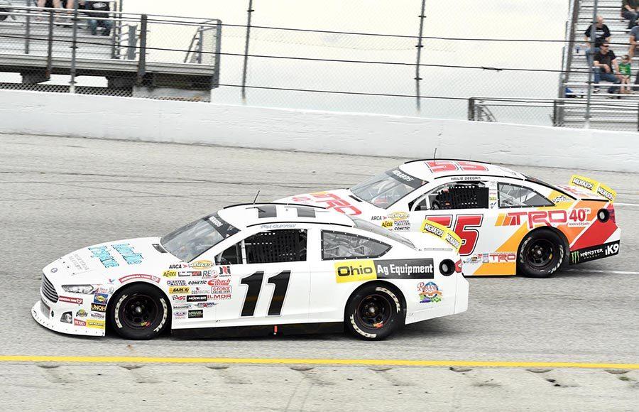 Rick Clifton (11) battles Hailie Deegan during Sunday's ARCA Menards Series race at Toledo Speedway. (Frank Smith Photo)