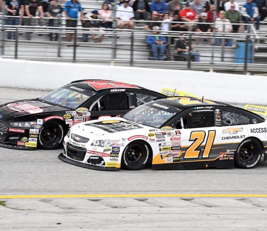 Sam Mayer (21) races under Corey Heim during Sunday's ARCA Menards Series race at Toledo Speedway. (Frank Smith Photo)