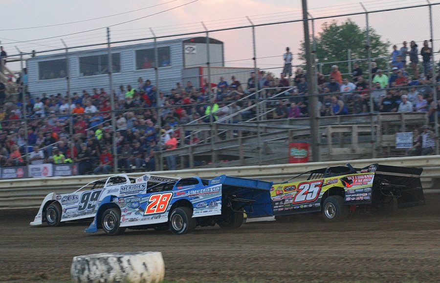Boom Biggs (99) Dennis Erb Jr. (28) and Shane Clanton race down the frontstretch Saturday at Wayne County Speedway. (Todd Ridgeway Photo)