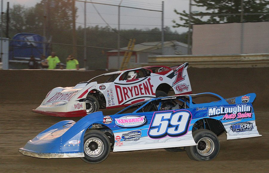 Shane McLoughlin (59) races under Brent Larson during Saturday's World of Outlaws Morton Buildings Late Model Series event at Wayne County Speedway. (Todd Ridgeway Photo)