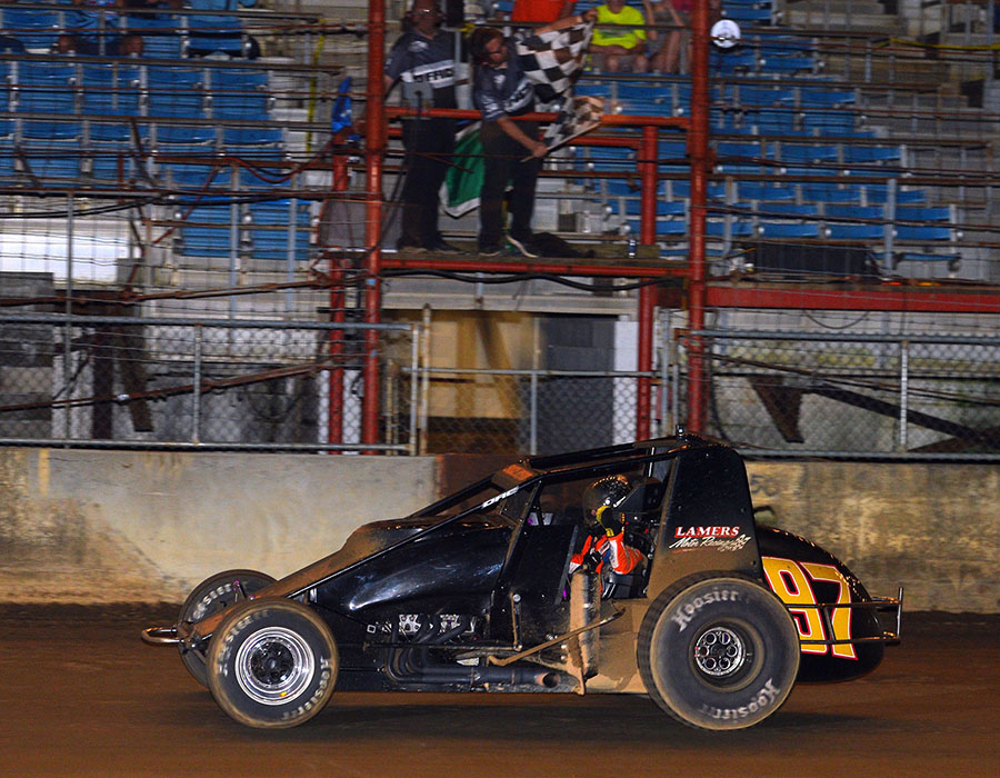Tyler Courtney takes the checkered flag to win the Hoosier Hundred Thursday at the Indiana State Fairgrounds. (Dave Heithaus Photo)