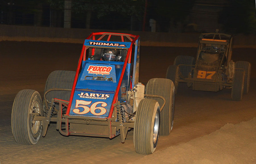 Kevin Thomas Jr. (56) battles Tyler Courtney during Thursday's Hoosier Hundred at the Indiana State Fairgrounds. (Dave Heithaus Photo)