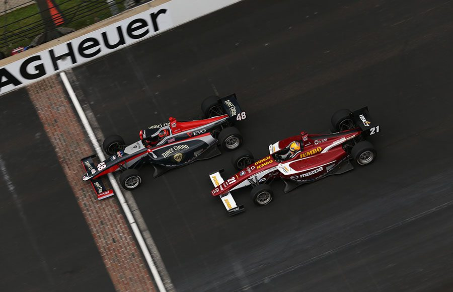 Ryan Norman (48) battles Rinus VeeKay during the Freedom 100 Friday at Indianapolis Motor Speedway. (IndyCar Photo)