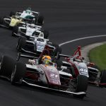 Rinus VeeKay (21) leads the pack during Friday's Freedom 100 at Indianapolis Motor Speedway. (IndyCar Photo)