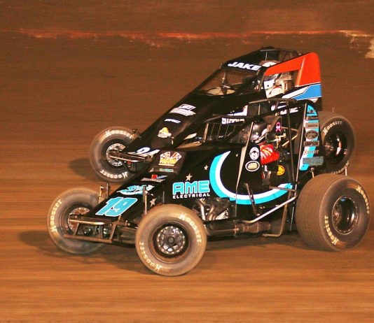 Hunter Schuerenberg (19) races under Jake Swanson at Perris Auto Speedway. (Doug Allen photo)
