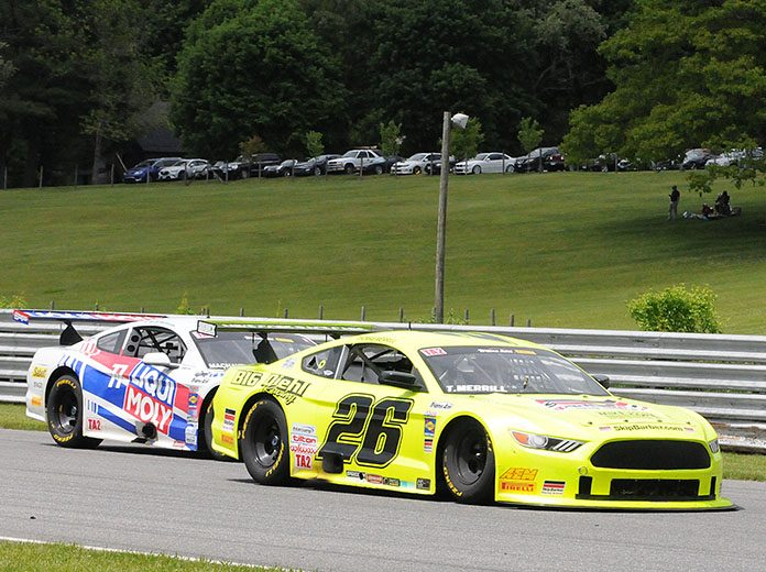 Thomas Merrill (26) races ahead of Dillon Machavern on Saturday at Lime Rock Park. (Dave Moulthrop Photo)