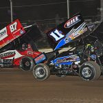 Aaron Reutzel (87) races ahead of Buddy Kofoid during Friday's Ollie's Bargain Outlet All Star Circuit of Champions event at Attica Raceway Park. (Mike Campbell Photo)