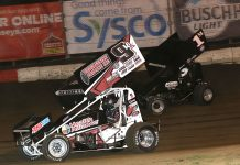 Kyle Schuett (9k) races past Jim Moughan during Friday's Built Ford Tough MOWA Sprint Car Series event at Jacksonville Speedway. (Brendon Bauman Photo)