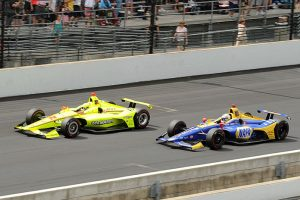 Simon Pagenaud (22) battles Alexander Rossi for the race lead during Sunday's Indianapolis 500. (Ginny Heithaus Photo)
