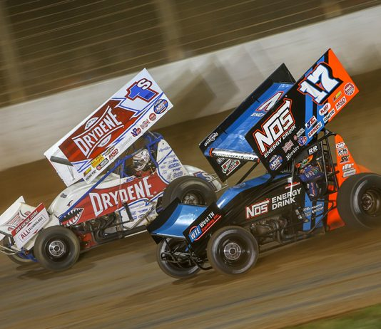 Sheldon Haudenschild (17) races alongside Logan Schuchart during Saturday's World of Outlaws NOS Energy Drink Sprint Car Series feature at The Dirt Track at Charlotte. (Adam Fenwick Photo)