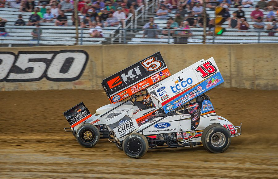 Donny Schatz (15) races under Shane Stewart during Monday's World of Outlaws NOS Energy Drink Sprint Car Series event at Lawrenceburg Speedway. (Dallas Breeze Photo)