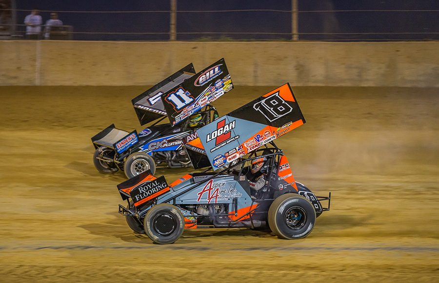 Ian Madsen (18) battles Buddy Kofoid during Monday's World of Outlaws NOS Energy Drink Sprint Car Series event at Lawrenceburg Speedway. (Dallas Breeze Photo)