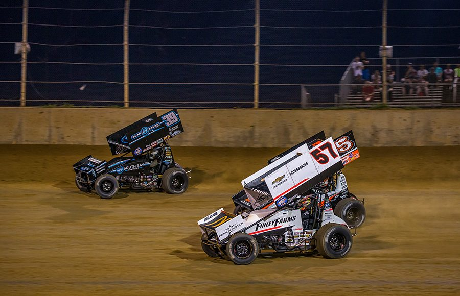 Kyle Larson (57), Shane Stewart (5) and Christopher Bell battle for position during Monday's World of Outlaws NOS Energy Drink Sprint Car Series event at Lawrenceburg Speedway. (Dallas Breeze Photo)