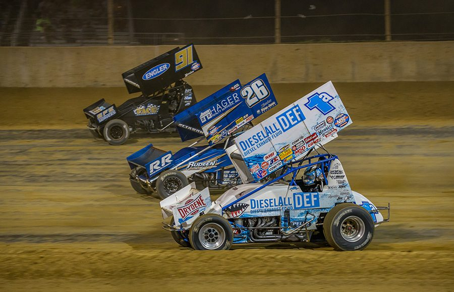 Jacob Allen (1a), Cory Eliason (26) and Cale Thomas race three-wide during Monday's World of Outlaws NOS Energy Drink Sprint Car Series event at Lawrenceburg Speedway. (Dallas Breeze Photo)
