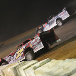 Brandon Overton (2) races under Chase Junghans at Cochran Motor Speedway. (Blake Harris photo)