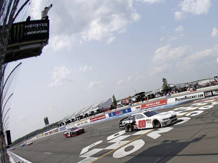 Cole Custer (00) crosses the finish line to win Saturday's NASCAR Xfinity Series race at Pocono Raceway. (HHP/Alan Marler Photo)