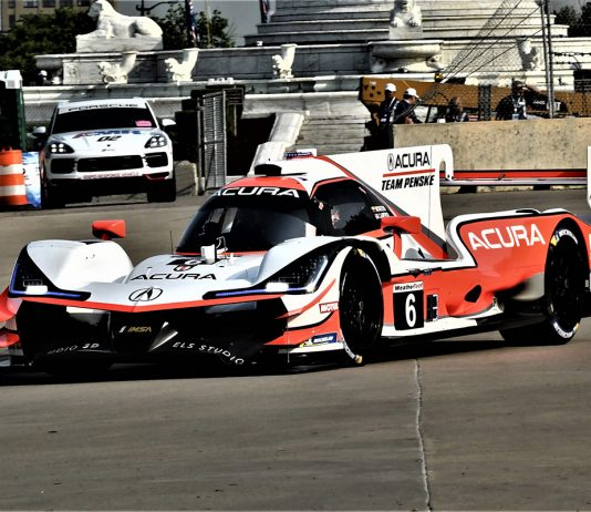 Juan Pablo Montoya and Dane Cameron en route to victory Saturday at Belle Isle Park. (Al Steinberg Photo)