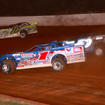 Brandon Sheppard (1) battles Ben Watkins (16) and Michael Brown at Lancaster Motor Speedway. (Justin Wilson photo)