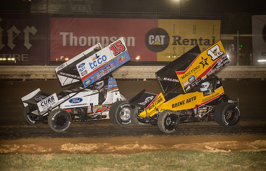 Donny Schatz (15) races ahead of Bill Balog during Friday's World of Outlaws NOS Energy Drink Sprint Car Series feature at Fairgrounds Speedway Nashville. (Dallas Breeze Photo)