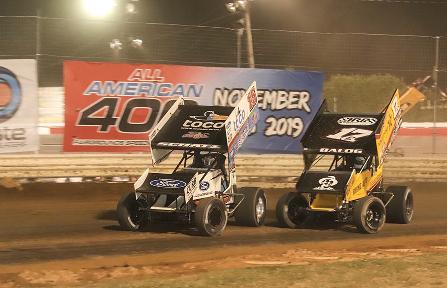 Donny Schatz (15) holds off Bill Balog during Friday's World of Outlaws NOS Energy Drink Sprint Car Series feature at Fairgrounds Speedway Nashville. (Brad Plant Photo)