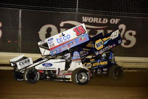 Donny Schatz (15) battles Brad Sweet during Friday's World of Outlaws NOS Energy Drink Sprint Car Series feature at Fairgrounds Speedway Nashville. (Mark Funderburk Photo)