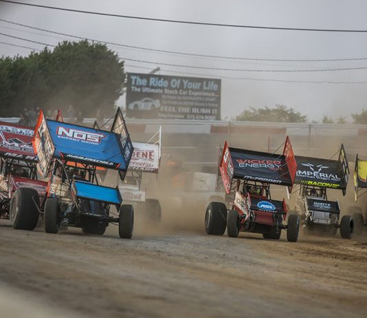 Sprint cars scream down the frontstretch on Friday evening at Fairgrounds Speedway Nashville. (Brad Plant Photo)