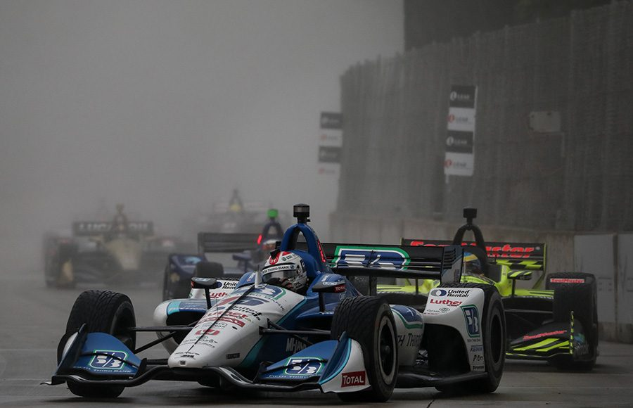 Graham Rahal (15) races ahead of a pack of cars during Saturday's NTT IndyCar Series event at Belle Isle Park. (IndyCar Photo)
