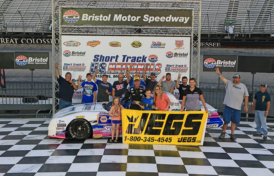 Chuck Barnes Jr. poses in victory lane after winning the street stock portion of the Short Track U.S. Nationals at Bristol Motor Speedway. (Chad Wells Photo)