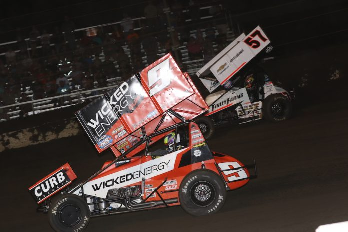 James McFadden (9) battles Kyle Larson at Fairbury American Legion Speedway. (Brendan Bauman photo)