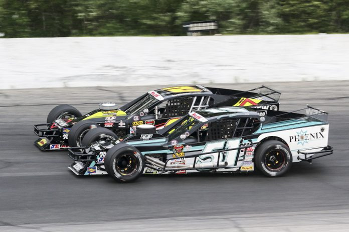 Justin Bonsignore (51) battles Doug Coby Wednesday night at Thompson Motorsports Park. (Dick Ayers photo)