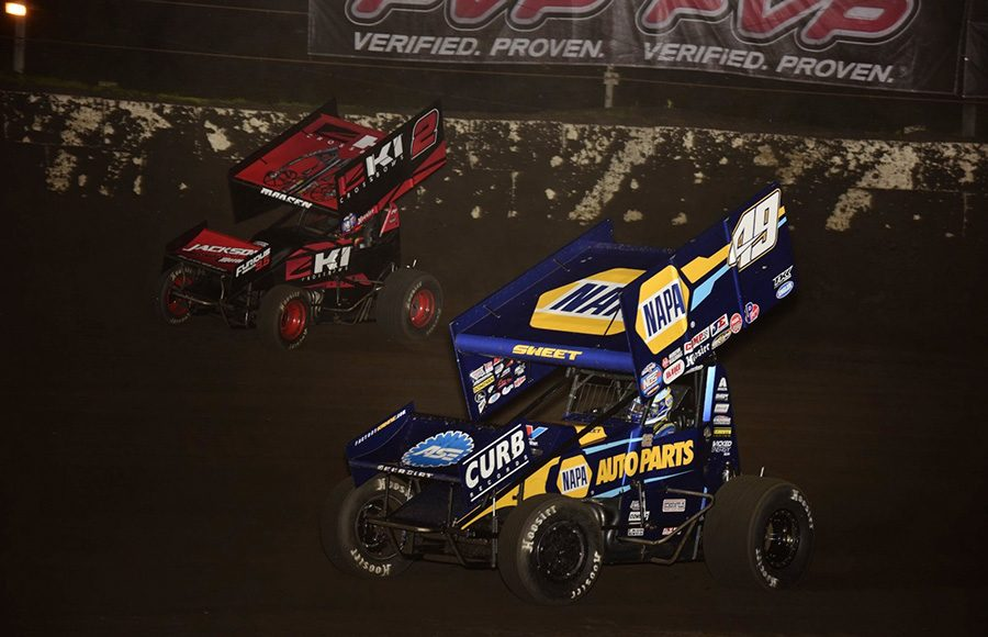 Brad Sweet (49) races under Kerry Madsen during Tuesday's World of Outlaws NOS Energy Drink Sprint Car Series event at Fairbury Speedway. (Mark Funderburk Photo)