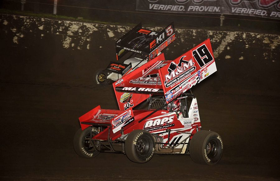 Brent Marks (19) works to the inside of Shane Stewart during Tuesday's World of Outlaws NOS Energy Drink Sprint Car Series event at Fairbury Speedway. (Mark Funderburk Photo)