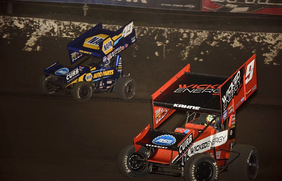James McFadden (9) battles teammate Brad Sweet during Tuesday's World of Outlaws NOS Energy Drink Sprint Car Series event at Fairbury Speedway. (Mark Funderburk Photo)