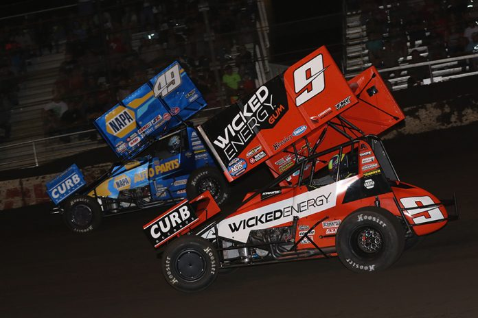 James McFadden (9) chases Brad Sweet during Tuesday's World of Outlaws NOS Energy Drink Sprint Car Series event at Fairbury Speedway. (Brendon Bauman Photo)