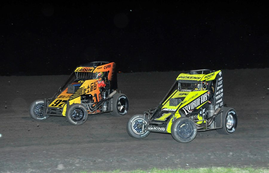 Michael Pickens (1) races under Kyle Larson during Wednesday's Indiana Midget Week event at Gas City I-69 Speedway. (Randy Crist Photo)