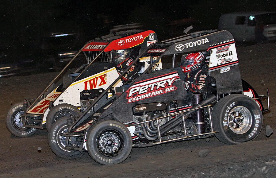 Kevin Thomas Jr. (5) battles alongside Tucker Klaasmeyer during Wednesday's Indiana Midget Week event at Gas City I-69 Speedway. (Jim Denhamer Photo)