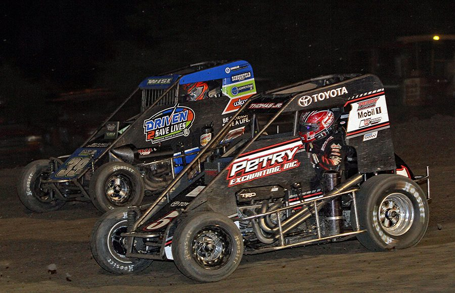 Kevin Thomas Jr. (5) races to the inside of Zeb Wise during Wednesday's Indiana Midget Week event at Gas City I-69 Speedway. (Jim Denhamer Photo)