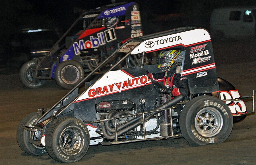 Jerry Coons Jr. (25) works the inside of Logan Seavey during Wednesday's Indiana Midget Week event at Gas City I-69 Speedway. (Jim Denhamer Photo)