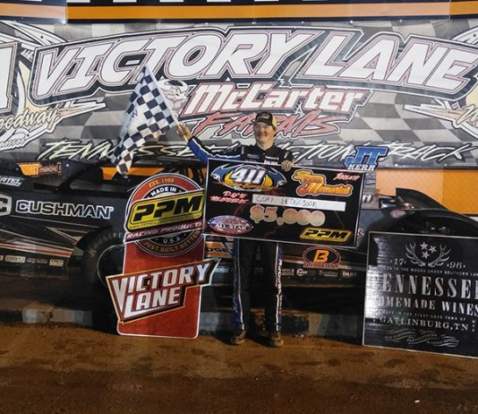 Cory Hedgecock stands in victory lane after winning Saturday's JT Kerr Memorial at 411 Motor Speedway. (Tim Owens Photo)