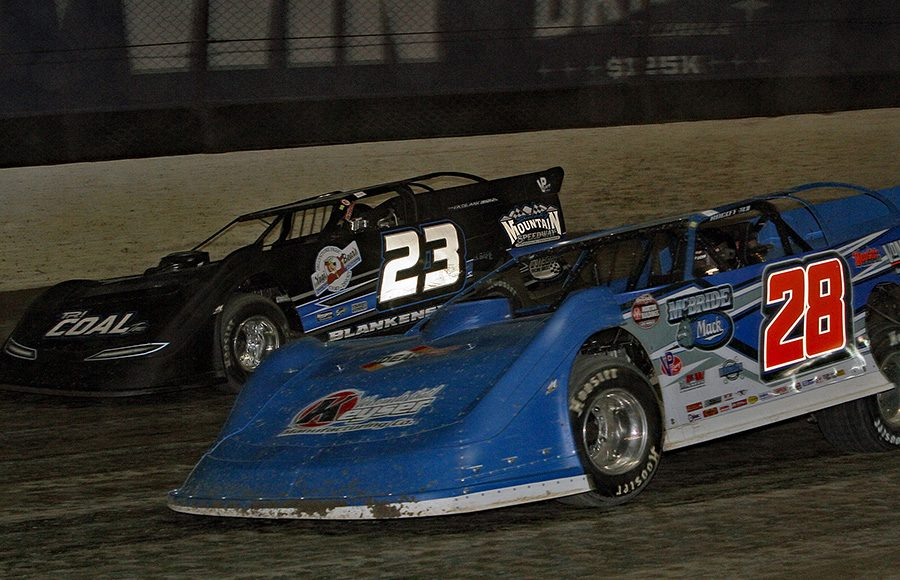 Dennis Erb Jr. (28) races alongside John Blankenship during Thursday's first Dirt Late Model Dream preliminary feature at Eldora Speedway. (Jim Denhamer Photo)