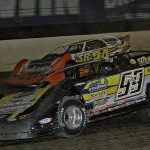 Frank Heckenast Jr. (99) races alongside Dylan Yoder during Thursday's first Dirt Late Model Dream preliminary feature at Eldora Speedway. (Jim Denhamer Photo)