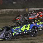 Chris Madden (44) races under Ricky Weiss during Thursday's second Dirt Late Model Dream preliminary feature at Eldora Speedway. (Jim Denhamer Photo)