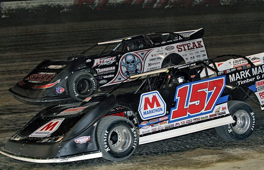 Mike Marlar (157) battles Shannon Babb during Thursday's second Dirt Late Model Dream preliminary feature at Eldora Speedway. (Jim Denhamer Photo)