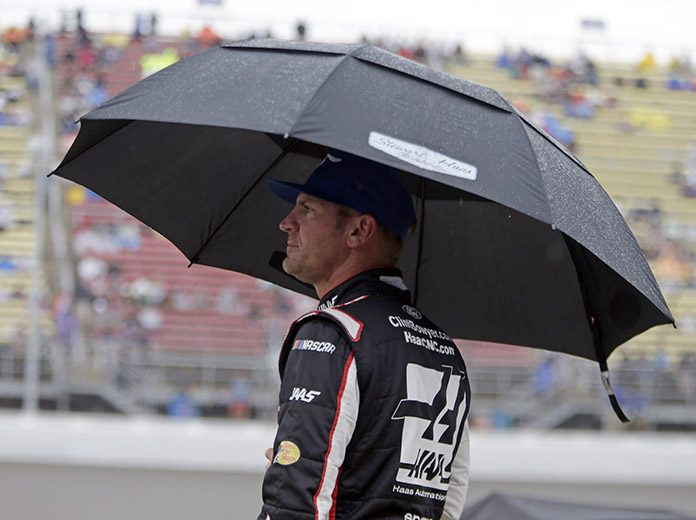 Clint Bowyer watches it rain on Sunday afternoon at Michigan Int'l Speedway. (HHP/Alan Marler Photo)