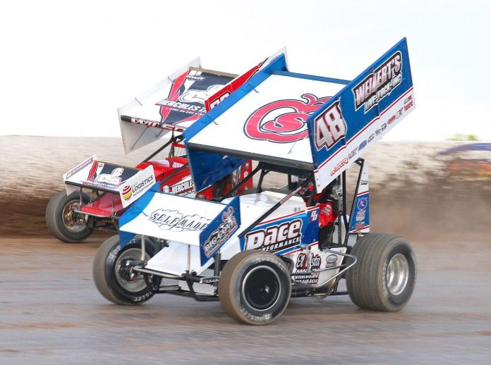 Danny Dietrich (48) races under Greg Wilson at Weedsport (N.Y.) Speedway. (Dan Demarco photo)